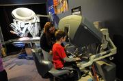 Doctors in training get some experience on the da Vinci surgical system at the Florida Hospital section of Otronicon.