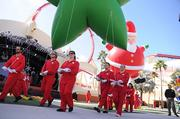 Macy's balloon handlers demonstrate their skill with a stroll around the park.