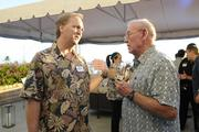 Kevin Bumgarner, left, editor of Pacific Business News, talks with Tom Smyth of Integrated Economic Solutions at PBN's Pau Hana at The Modern Honolulu.