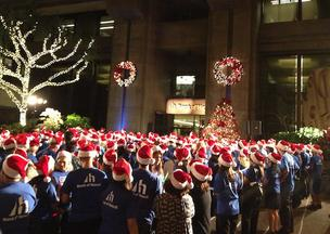 Some 400 Bank of Hawaii employees gathered outside the bank's downtown Honolulu headquarters to sing carols and gather holiday donations for nonprofit organizations.