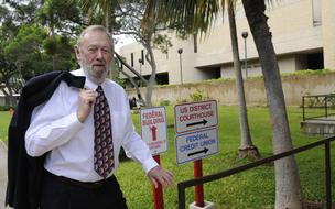 Cliff Slater, chairman of Honolulutraffic.com and one of the plaintiffs in the federal lawsuit against the City and County of Honolulu over the $5.16 billion rail project, enters U.S. District Court in Honolulu Wednesday.
