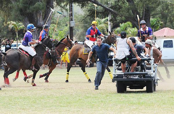 """Alex O'Loughlin, who plays Steve McGarrett on the CBS drama """"Hawaii Five-0,"""" is seen chasing after a suspect in a scene filmed at the Hawaii Polo Club on Oahu."""