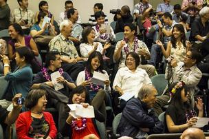 University of Hawaii John A. Burns School of Medicine students and their families react after learning where they will be going for their residency programs after competing for slots in the National Resident Matching Program.