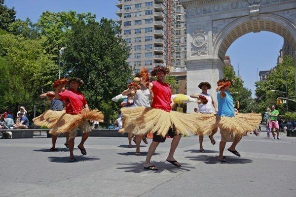 "Dancers from the Na Lei Hulu I Ka Wekiu hula halau perform in Washington Square Park in New York City as part of Hawaiian Airlines' ""hit-and-run"" hula promotion."