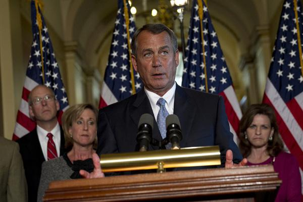 "John Boehner has accused President Obama of using the military as a ""prop."""