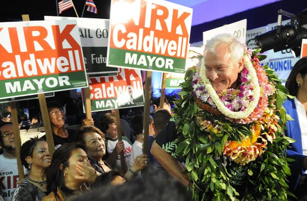 Kirk Caldwell greets supporters after being declared the winner in the Honolulu mayor's race.