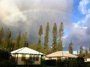 A rainbow frames some plantation-style homes on the Hawaiian island of Lanai.