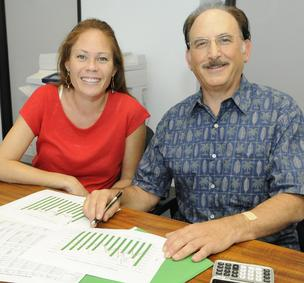 Indigenous Soap Co. owner Love Chance, left, is seen with  Joseph Burns, Oahu center director for the Hawaii Small Business Development Center, who has been advising her business for several years.