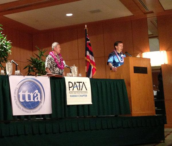 Hawaiian Airlines President and CEO Mark Dunkerley, right, answers questions from the audience at Pacific Asia Travel Association Hawaii Chapter's 2013 Outlook and Economic Forecast. Chris Kam, director of market trends for the Hawaii Visitors & Convention Bureau, left, moderated during the program.