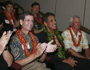 From left, Al Landon of Bank of Hawaii, former Lt. Gov. Duke Aiona and Hawaii Convention Center General Manager Joe Davis applaud during PBN's 2008 Forty Under 40 event.