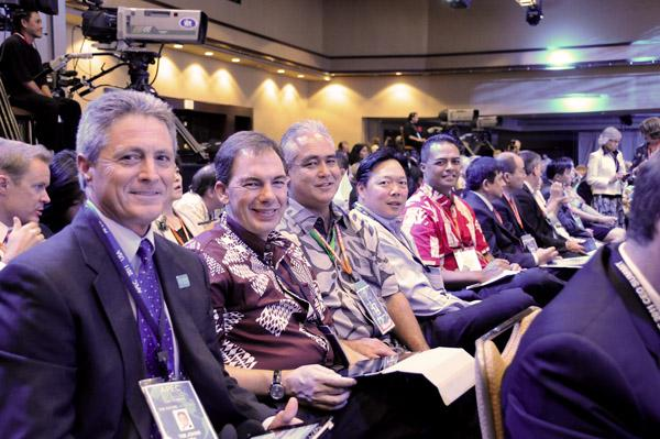 Members of the 2011 APEC Hawaii Host Committee at the Asia-Pacific Economic Cooperation 2011 CEO Summit on Friday at the Sheraton Waikiki in Honolulu. From left: Vice Chairman Timothy E. Johns, senior vice president, Hawaii Medical Service Association; Mark Dunkerley, president and CEO, Hawaiian Airlines Inc.; Mike McCartney, president and CEO, Hawaii Tourism Authority; and committee Chairman Peter Ho, chairman, president and CEO, Bank of Hawaii. Kekoa Kalihiwa, director of external affairs for First Wind, is on the far right.