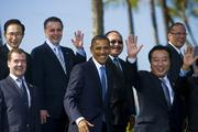 President Barack Obama, middle, smiles while posing for pictures between Russian president Dmitry Medvedev, left, and Japan Prime Minister Yoshihiko Noda, right, during an APEC leaders family photo on Sunday at Ko Olina Resort in Hawaii.