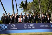 The 21 APEC leaders pose for the APEC family photo Sunday at Ko Olina Resort in Hawaii.