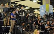 Members of the media await U.S. Treasury Secretary Timothy Geithner at the Hawaii Convention Center in Honolulu after Geithner met with finance ministers from the 21 Asia-Pacific Economic Cooperation nations.