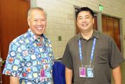 APEC volunteer Gregg Takeyama of the University of Hawaii, with Neal Yokota, president and CEO of Stryker Weiner & Yokota Public Relations.