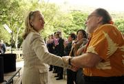 U.S. Secretary of State Hillary Rodham Clinton greets Gov. Neil Abercrombie at the East-West Center in Honolulu.