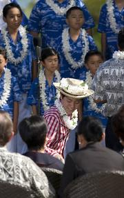 The Honolulu Boy Choir sang for the spouses of APEC dignitaries who were invited to a luncheon hosted by first lady Michelle Obama at Kualoa Ranch in Kaneohe, Hawaii, on Sunday.
