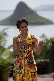 First lady Michelle Obama jokes with the media before greeting the spouses of dignitaries attending the APEC Economic Leaders' meeting who were invited to a luncheon at Kualoa Ranch in Kaneohe, Hawaii, on Sunday.