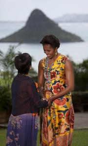 First lady Michelle Obama greets Selina Tsang, wife of Donald Tsang Yam-kuen, chief executive of the Hong Kong Special Administrative Region, who, along with other spouses of dignitaries attending the APEC Economic Leaders' meeting, was invited for a luncheon at Kualoa Ranch in Kaneohe, Hawaii, on Sunday.