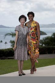 First lady Michelle Obama and Lien Fang Yu, wife of Lien Chan of Taiwan, pose for a photo at Kualoa Ranch in Kaneohe, Hawaii, on Sunday. Lien Chan was in Hawaii to attend the APEC Economic Leaders' meeting.