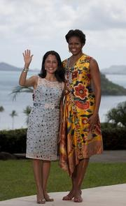First lady Michelle Obama and Nadine Heredia, first lady of Peru, wave for the media before a luncheon at Kualoa Ranch in Kaneohe, Hawaii, on Sunday. President Ollanta Humala of Peru was in Hawaii to attend the APEC Economic Leaders' meeting.