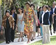 First lady Michelle Obama leads the spouses of APEC dignitaries to hear a performance by the Honolulu Boy Choir at Kualoa Ranch in Kaneohe, Hawaii, on Sunday.