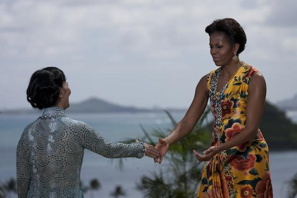 First lady Michelle Obama greets Madam Mai Thi Hanh, first lady of Vietnam, who, along with other spouses of dignitaries attending the APEC Economic Leaders' meeting, was invited to a luncheon at Kualoa Ranch in Kaneohe, Hawaii, on Sunday.
