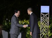 President Barack Obama greets Japanese Prime Minister Yoshihiko Noda before a state dinner for the leaders of the Asia-Pacific Economic Cooperation nations Saturday night at the Hale Koa Hotel in Waikiki.