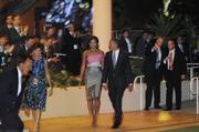 President Barack Obama and first lady Michelle Obama enter after leaders from the Asia-Pacific Economic Cooperation nations, and their spouses, took their seats for the evening entertainment by Manu Boyd and his hula halau following a state dinner for the APEC leaders Saturday night at the Hale Koa Hotel in Waikiki.