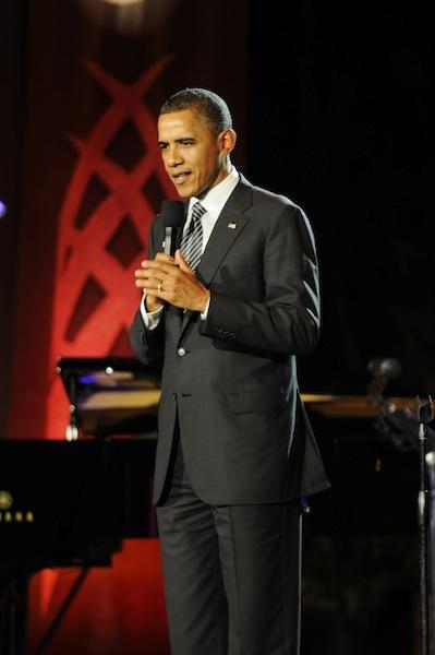 President Barack Obama addresses leaders from the Asia-Pacific Economic Cooperation nations, and their spouses, prior to the evening entertainment by Manu Boyd and his hula halau, following a state dinner for the APEC leaders Saturday night at the Hale Koa Hotel in Waikiki.