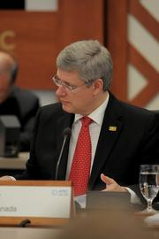 Canadian Prime Minister Stephen Harper at the conference table at the 19th APEC Economic Leaders' meeting Sunday at the JW Marriott Ihilani Resort and Spa at Ko Olina in Hawaii.