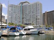 "The ""Hawaii Five-0"" scene was filmed at the Ala Wai Small Boat Harbor in Waikiki, with the Ilikai hotel in the background."
