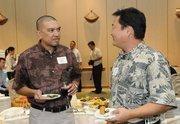 Bryan Andaya of L&L Franchise and Evan Watarida of Central Pacific Bank.