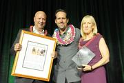 From left, Bob Charlet, Scott Meichtry,  co-owner and executive vice president of The Hawaii Group, Deborah Crown, dean of the Hawaii Pacific University College of Business Administration at the Pacific Business News Business Leadership Hawaii event at the Sheraton Waikiki.
