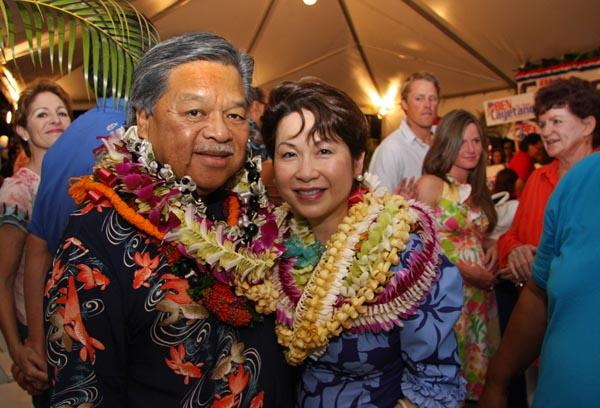 Former Hawaii Gov. Ben Cayetano poses with his wife, Vicky, after getting the most votes in the primary election for Honolulu mayor. Cayetano will face Kirk Caldwell, who got the second-highest number of votes in the primary, in a runoff in the general election in November.