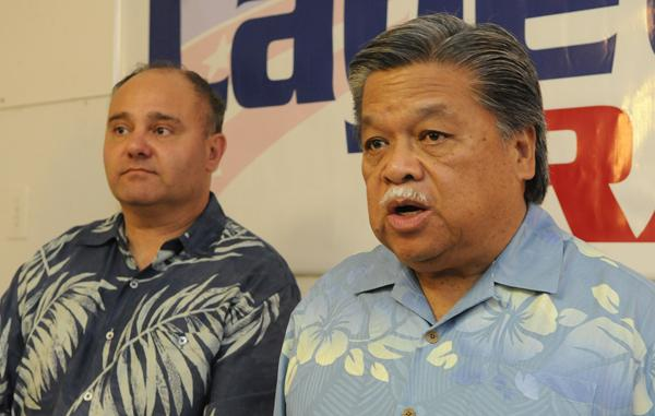 University of Hawaii professor Panos Prevedouros and Honolulu mayoral candidate and former Hawaii Gov. Ben Cayetano are seen at a news conference Friday, discussing the federal rail lawsuit.