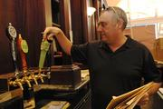 Co-owner Danny Dolan checks the beer taps at Ferguson's Irish Pub in downtown Honolulu.