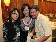 from left, Deborah Sharkey, president of Makana Communications, finalist Renee Awana and Jeff Awana at the 2012 Women Who Mean Business event at The Royal Hawaiian in Waikiki.