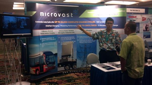 Lance Deng, vice president of corporate strategy for Microvast, shows Hawaii Eco Project Principal Charles Wang the latest battery storage technology the Texas-based company is selling to renewable energy companies at the 2012 Asia-Pacific Clean Energy Summit and Expo at the Hawaii Convention Center in Waikiki.