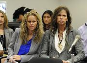 Attorney Dina Lapolt and Aerosmith's Steven Tylerare seen at a Hawaii Senate hearing Friday in Honolulu. The two testified, along with Mick Fleetwood, in support of Senate Bill 465, Hawaii's proposed anti-paparazzi bill.