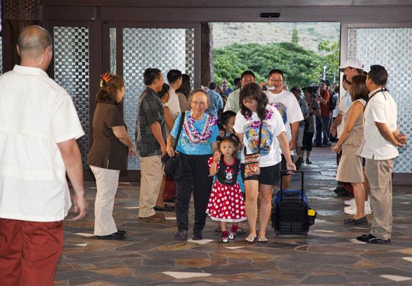 Members of the Chun family enter the lobby as Aulani, a Disney Resort & Spa opened to the public Monday at Ko Olina Resort in Hawaii.