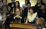 Senate President Donna Mercado Kim delivers her opening day address at the Hawaii Legislature in Honolulu Wednesday as Gov. Neil Abercrombie looks on.