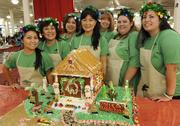 First Insurance Co. of Hawaii employees show off their Christmas gingerbread house at the 13th-annual Easter Seals Hawaii Gingerbread Family Festival at the Blaisdell Center in early December. From left, is Allison Ohama, Debra Nawatani, Georgia Vieau, Carolyn Misajon, Addie Melim, Kimette Buendia and Alexa Ferreira.