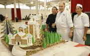 From left, Hilton Hotels Executive Chef Jeffrey Vigilla, Executive Pastry Chef Andre Fusero, and Assistant Pastry Cook Kyle Goto created a a replica of the Neuschwanstein Castle in Germany at the 13th annual Easter Seals Hawaii Gingerbread Family Festival at the Blaisdell Center in early December.