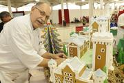 Andre Fusero, executive pastry chef for Hilton Hotels, works on a replica of the Neuschwanstein Castle in Germany at the 13th-annual Easter Seals Hawaii Gingerbread Family Festival at the Blaisdell Center in early December.
