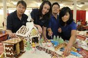 "Island Insurance  participated in the 13th-annual Easter Seals Hawaii Gingerbread Family Festival at the Blaisdell Center in early December. From left, underwriters Reed Tokairin, Dani Ulmann and Takushi Nagayama, and Assistant Vice President of Surety Tricia Miyashiro, create a gingerbread house with the theme ""O Holy Night."""
