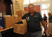 Ed Hampton, senior refrigeration technician for Desert Isle Beverages, finishes the hook-up to the ice machines at Ferguson's Irish Pub in downtown Honolulu.
