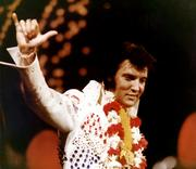 "Elvis Presley is seen in this photo from his 1973 ""Aloha from Hawaii"" concert. Elvis Presley Enterprises Inc. said Wednesday that it has teamed with the Hilton Hawaiian Village Waikiki Beach Resort, Hilo Hattie, the Hard Rock Cafe Honolulu and Teddy Bear World to offer a six-day, five-night travel package in January 2013 for fans to explore Presley's Hawaii."