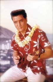 "Elvis Presley is seen in this still from the movie ""Blue Hawaii."" Elvis Presley Enterprises Inc. said Wednesday that it has teamed with the Hilton Hawaiian Village Waikiki Beach Resort, Hilo Hattie, the Hard Rock Cafe Honolulu and Teddy Bear World to offer a six-day, five-night travel package in January 2013 for fans to explore Presley's Hawaii."