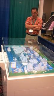 Frank Emura, a department manager for Hitachi, looks on at his company's Smart City project at the 2012 Asia-Pacific Clean Energy Summit and Expo at the Hawaii Convention Center in Waikiki
